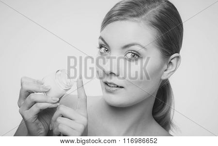 Woman Applying Cream On Her Skin Face.