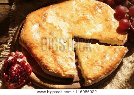 Pie With Cheese Submitted With Grapes And A Pomegranate