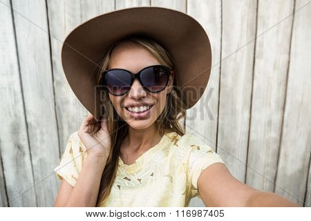 Young smiling women with glasses taking a selfie