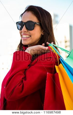 Girl smiling doing her shopping with sunglasses