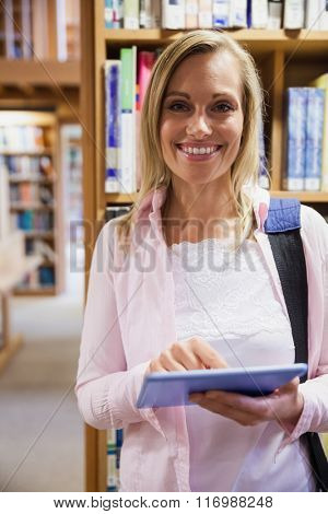 Female student using tablet in library at the university