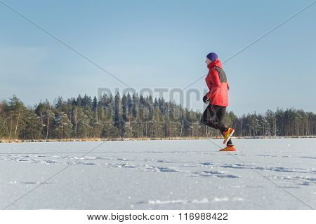 Trail runner man in winter sport race outdoor