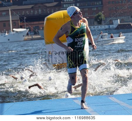 STOCKHOLM - AUG 22 2015: Swimmer Henri Schoeman (RSA) climbing up from the water in the Men's ITU World Triathlon series event August 22 2015 in Stockholm Sweden