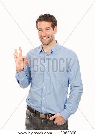 Portrait of smiling young man showing okay gesture