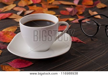 American Cup Of Coffee With Fallen Autumn Leaves