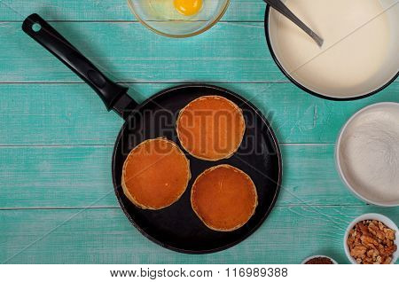 Pan With Pancakes And Ingredients For Making Pancakes