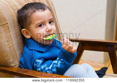 Sad Boy Eating Lollipop