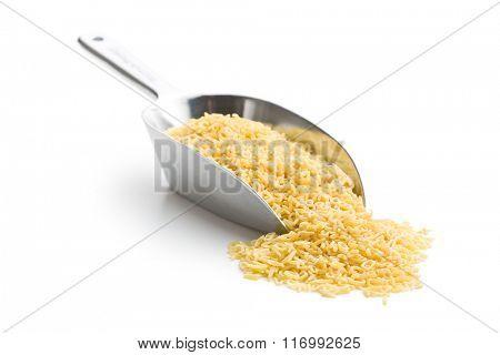 alphabet pasta in metal scoop