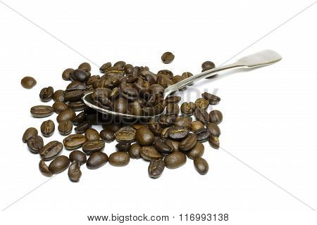 Coffee Grains In A Silver Spoon On A White Background