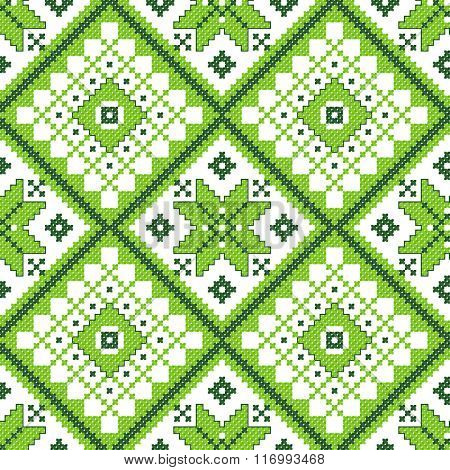 green embroidered good like handmade cross-stitch ethnic Ukraine pattern. spring color for St Patrick day