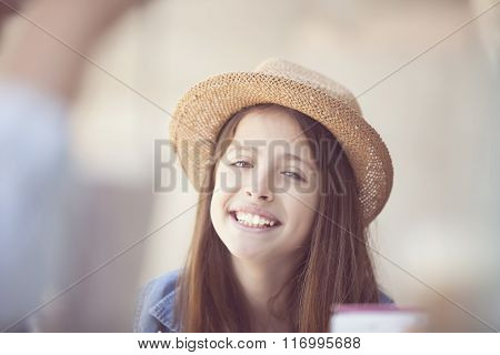 student with straw hat