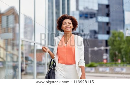 happy young african american businesswoman in city