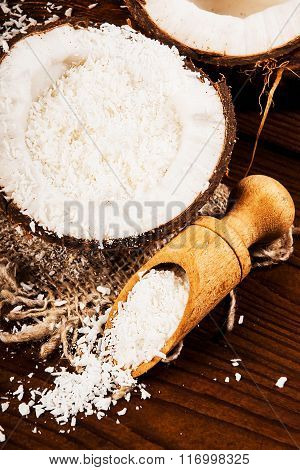 Coconut and coconut chips on a wooden background