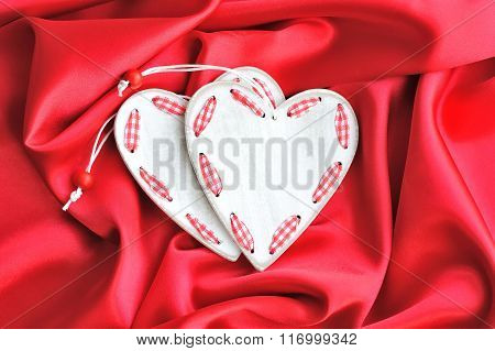 Wooden White Hearts On Red Satin Background