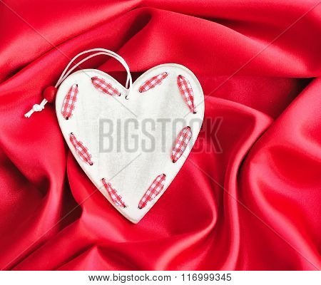 Wooden White Heart On Red Satin Background