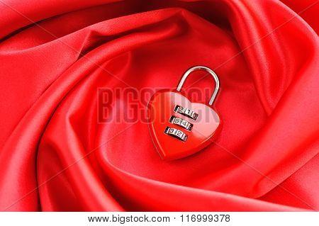 Padlock Heart-shape On Satin Fabric Background