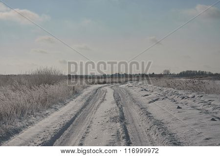 Snowy road in countreyside. Russia Siberia. Sunny day. clear blue sky