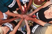 Постер, плакат: Team With Hands Together After Competition
