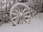 Old Wagon Wheel On Snow poster