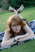picture of clevage  - a beautiful redhead with glasses in the sun - JPG