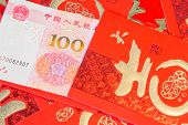 Постер, плакат: Pile Of Red Chinese Envelopes With Money