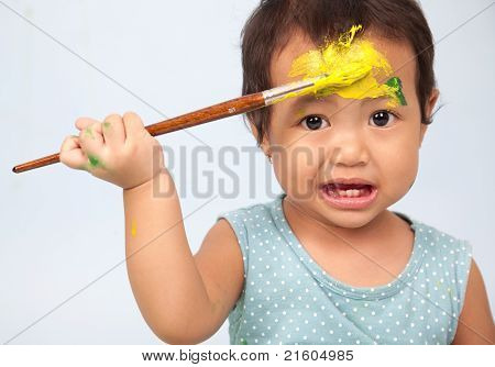 Cute Girl Playing With Brush And Paint