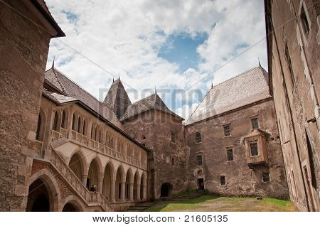 Courtyard of a Romanian fortified castle in a sunny day