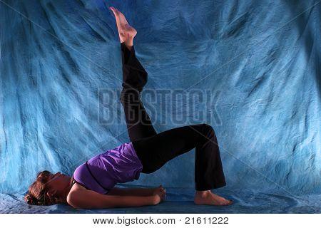 Woman In One Legged Bridge Yoga Pose