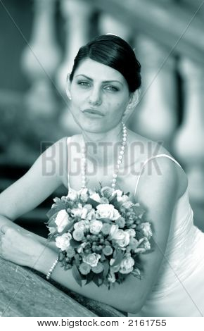 Bride In White With Bouquet