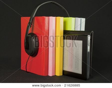 Audio Books Concept -  Colorful Books With Headphones And Electronic Book Reader On Black Background