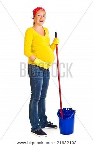 Tired pregnant woman cleaning the floor isolated on white