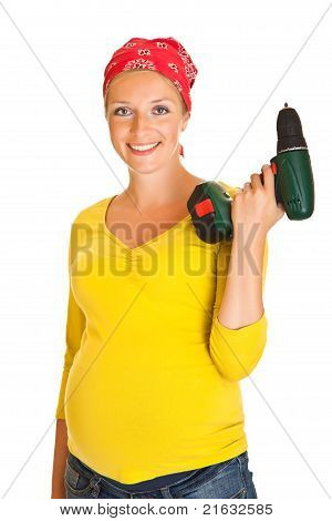 Pregnant woman with powertools isolated on white