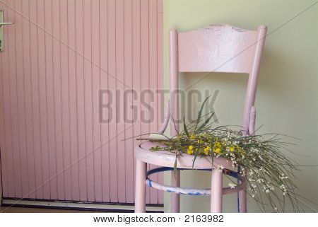 Old Pink Chair And Flowers