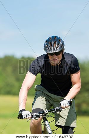 Sportive Man Mountain Biking Uphill Sunny Meadows