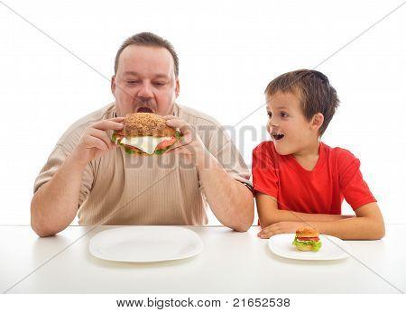 Man And Boy With Hamburgers