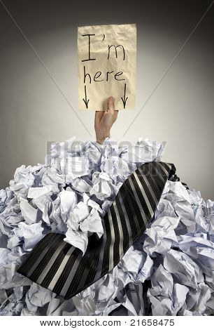 Businessman Buried In Crumpled Papers