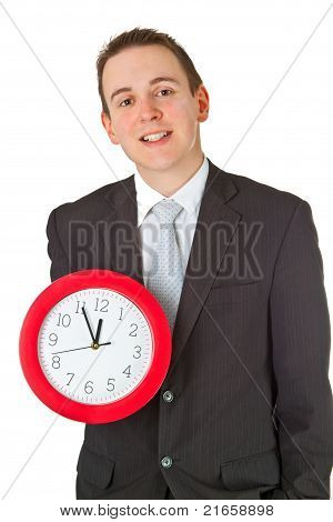 Young Businessman Holding A Clock