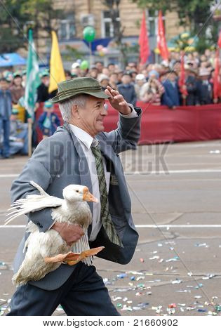 Man Holds A Goose