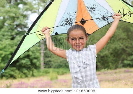 Girl flying her kite
