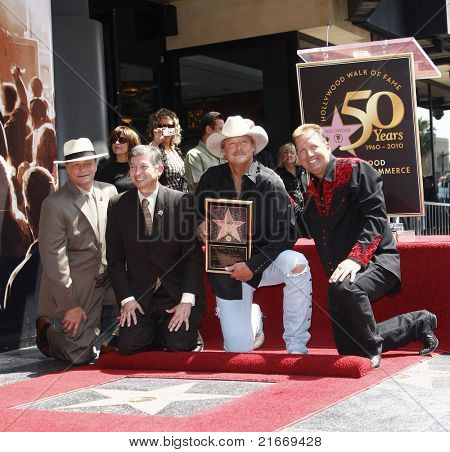 LOS ANGELES - APR 16: Leron Gubler, Alan Jackson and Shawn Parr at a ceremony where Alan Jackson receives the 2405th star on the Hollywood Walk of Fame, Los Angeles, California on April 16, 2010