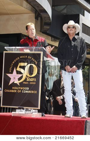LOS ANGELES - APR 16: Shawn Parr and Alan Jackson at a ceremony where Alan Jackson receives the 2405th star on the Hollywood of Fame, Los Angeles, California on April 16, 2010
