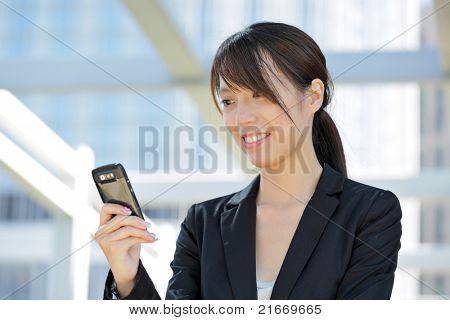 business woman using mobile cell phone