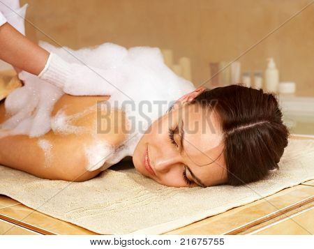 Young woman in hammam or turkish bath.