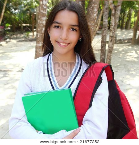 hispanic latin mexican teenager student girl with backpack in the park