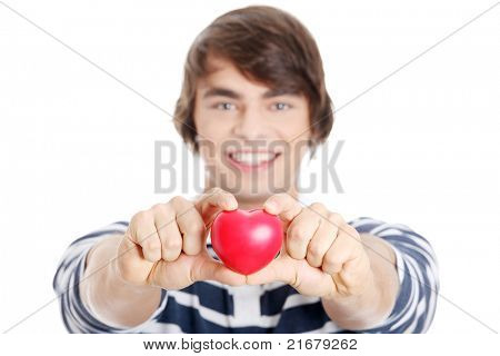 Young man with heart. Isolated on white background.