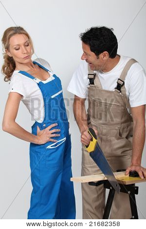 Couple doing woodwork