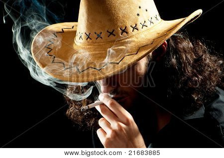 Man in cowbow hat smoking
