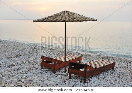 two chairs and umbrella on the beach