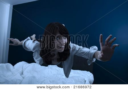 Conceptual image of a beautiful young woman fluctuate while dreaming