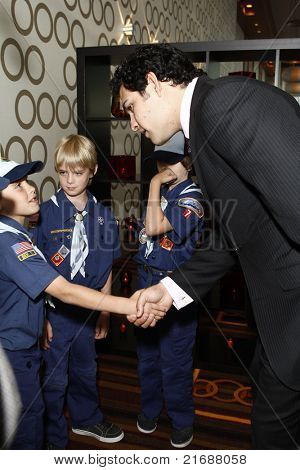 LOS ANGELES - MAY 10:  Mark Sanchez and unidentified boy scouts as Mark Sanchez of the NFL Jets is honored by the Inner City Games LA + Hollenbeck Youth Center in Los Angeles, CA on May 10, 2010